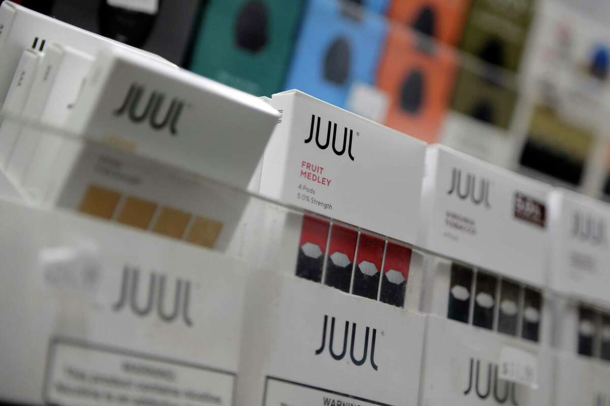 FILE - In this Dec. 20, 2018, file photo Juul products are displayed at a smoke shop in New York. Humble ISD's board of trustees recently approved $327,000 for vape detectors for the district as a way to curb the use of vaping in areas that are difficult to monitor, like bathrooms.