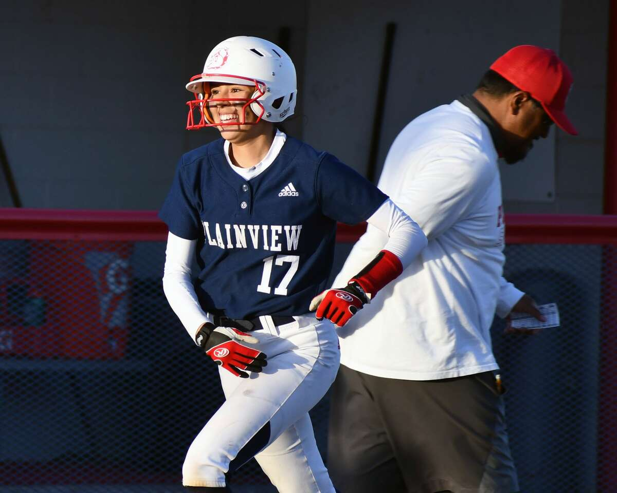 Plainview's Mikayla Carrillo is congratulated by head coach Enrique Villa after her two-run home run in a District 3-5A softball game against Amarillo Tascosa on Friday at Lady Bulldog Park.