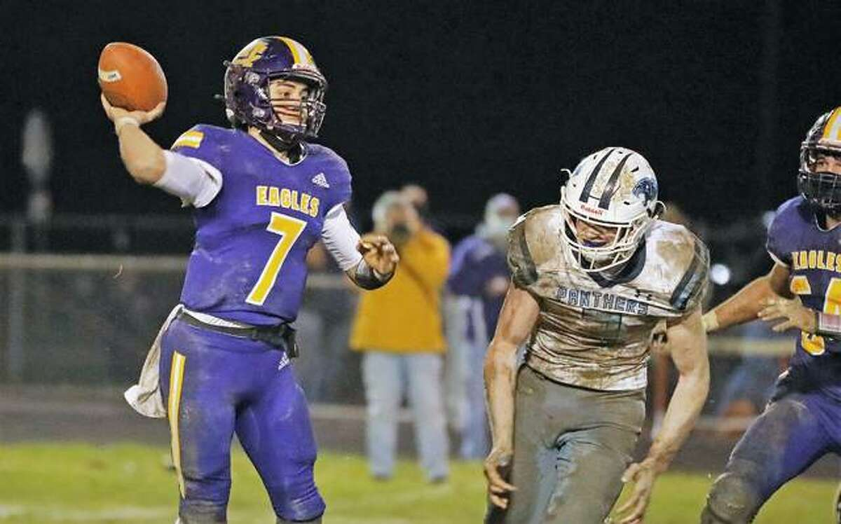 Civic Memorial quarterback Bryer Arview (7) passes the ball as Jersey's Cal Gorman (2) closes in Friday night at Hauser Field. CM won the game 14-7.