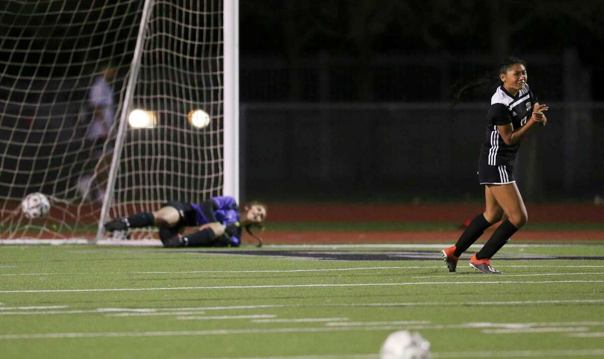 Steele's Noelani Ajel (13) reacts as she scores the deciding penalty kick against Madison goalkeeper Mia Wildeman during their Class 6A first round girls soccer playoff game at Steele High School on Friday, Mar. 26, 2021. Steele defeated Madison, 3-2, in penalty kicks after two overtime periods.