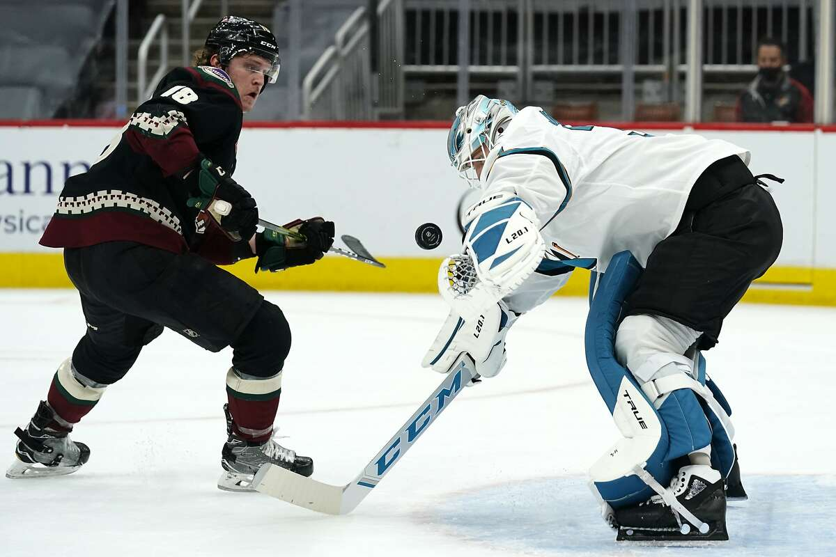 Sharks goaltender Martin Jones makes a save against Christian Dvorak, who scored twice for the Coyotes in their victory.