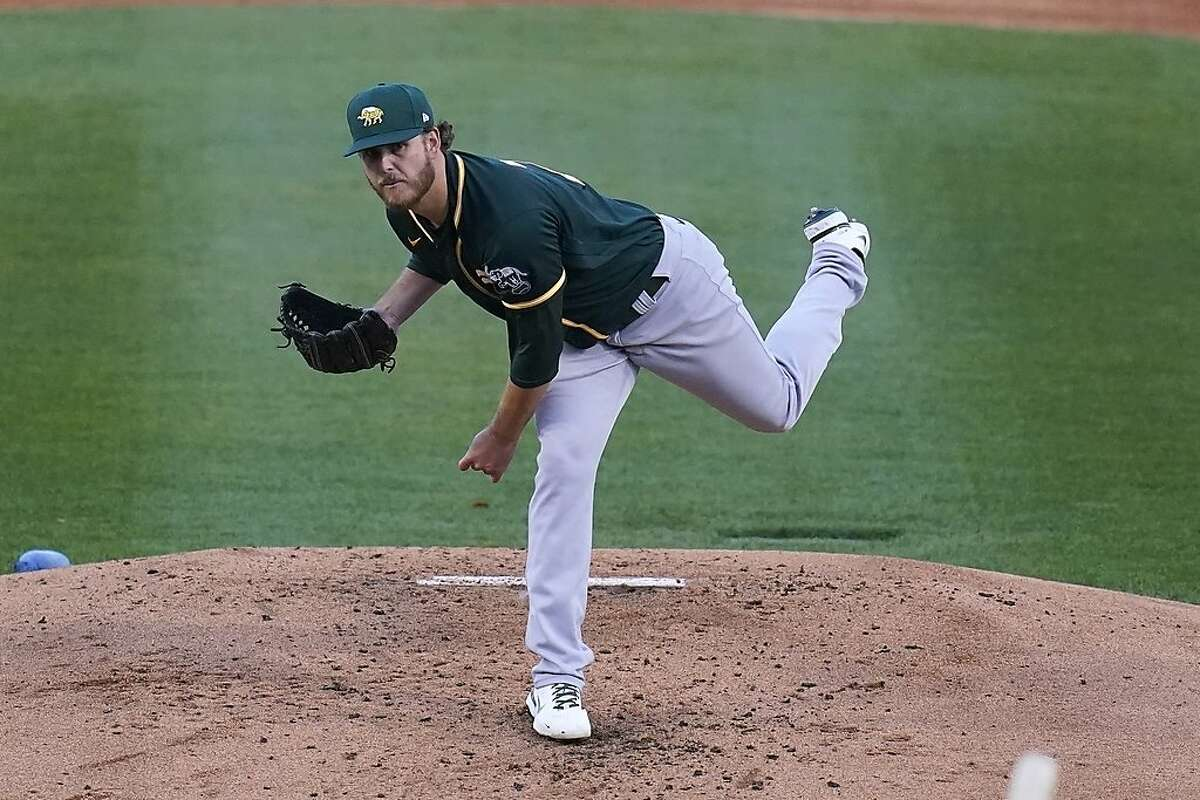 Oakland Athletics starting pitcher Cole Irvin throws to a Los Angeles Dodgers batter during the second inning of a spring training baseball game Friday, March 26, 2021, in Phoenix. (AP Photo/Ross D. Franklin)