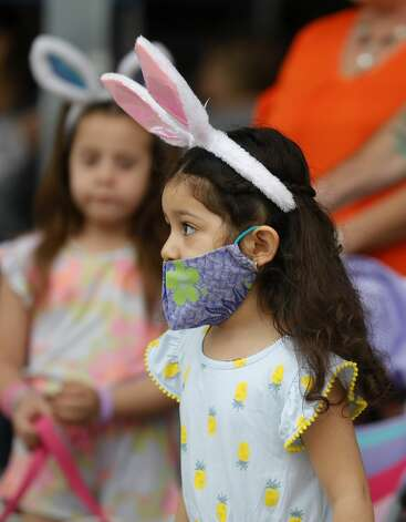 Wendy Carrillo wears a set of bunny ears to go along with her face mask at East Montgomery County Improvement District's Eggcellent Event and Spring Mini-Market at New Caney Middle School, Saturday, March 27, 2021, in New Caney. Children were also able to take part in an Easter egg hunt with 80,000 brightly colored eggs scattered across Don Ford Stadium. Photo: Jason Fochtman/Staff Photographer / 2021 © Houston Chronicle