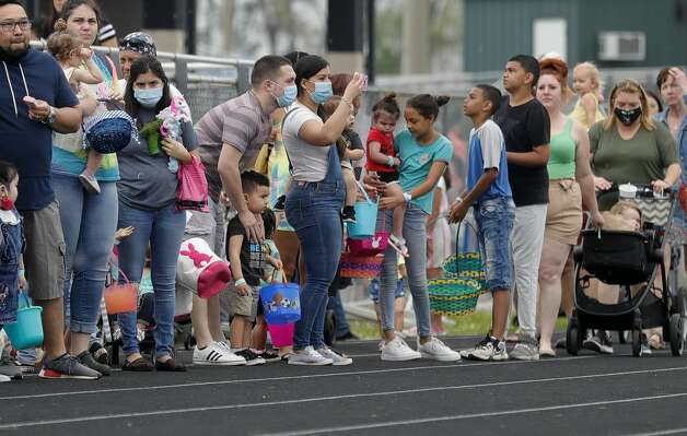 Parents and children make their way to the field to take part in an egg hunt during East Montgomery County Improvement District's Eggcellent Event and Spring Mini-Market at New Caney Middle School, Saturday, March 27, 2021, in New Caney. Photo: Jason Fochtman/Staff Photographer / 2021 © Houston Chronicle