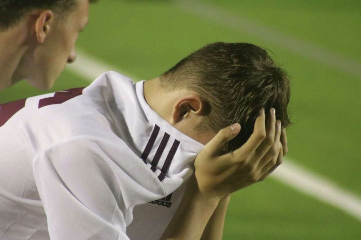 As the final minutes of overtime count down, a Deer Park player senses defeat is at hand.