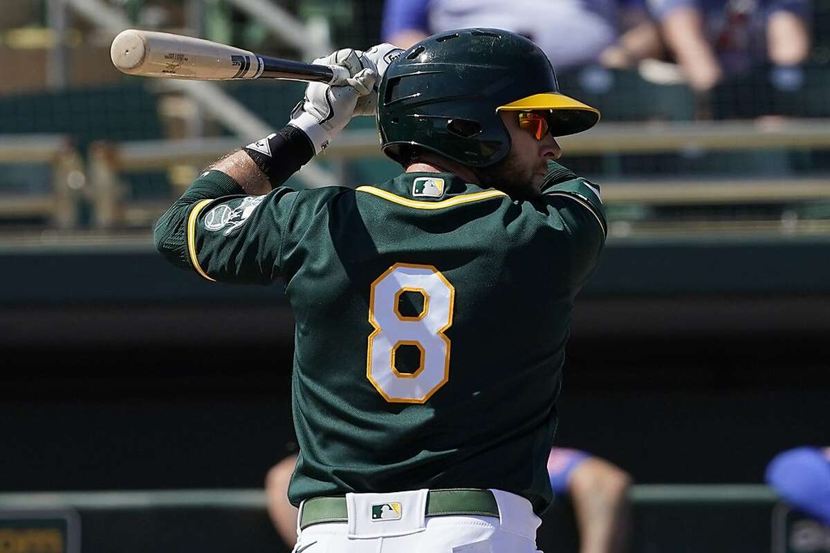 Oakland Athletics' Jed Lowrie against the Chicago Cubs during a spring training baseball game, Friday, March 19, 2021, in Mesa, Ariz. (AP Photo/Matt York)