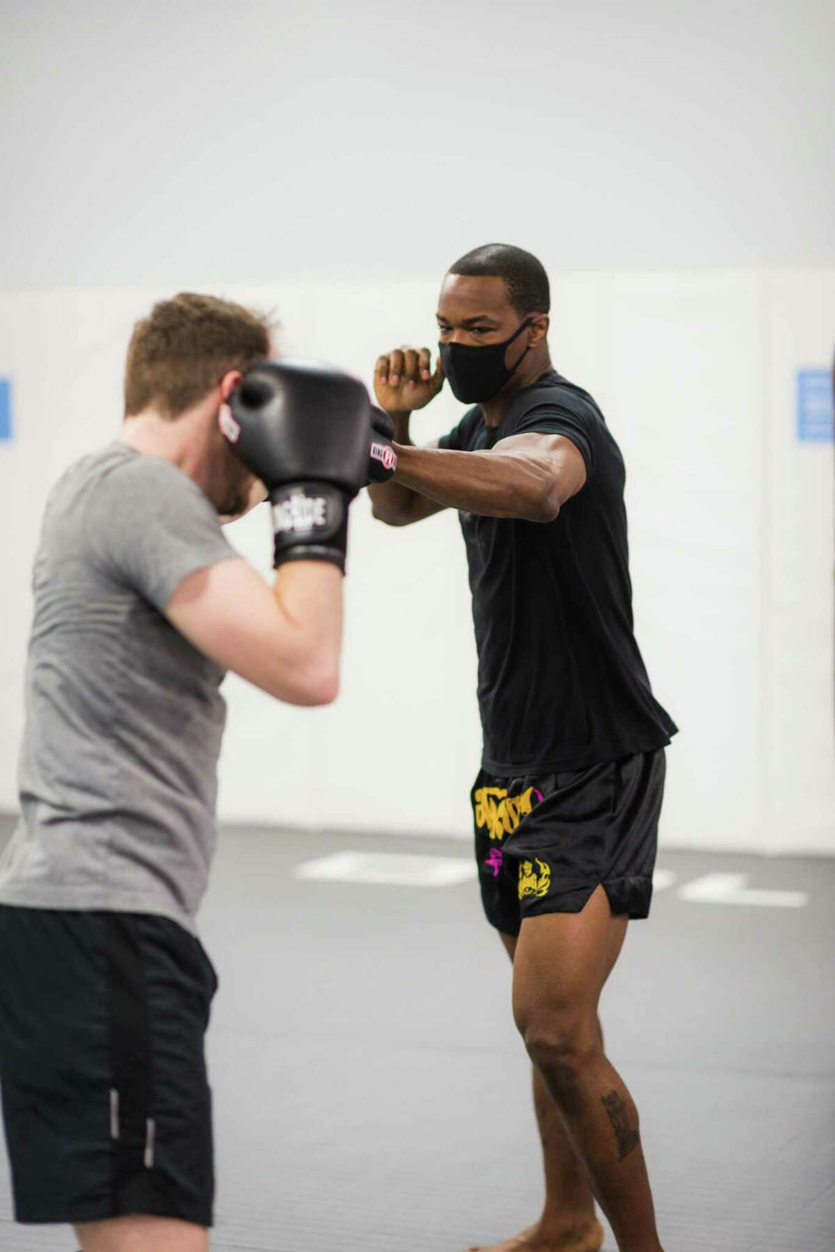 Ravlin Martial Arts & Fitness owner and head instructor Angelus McFarlane spars with a client