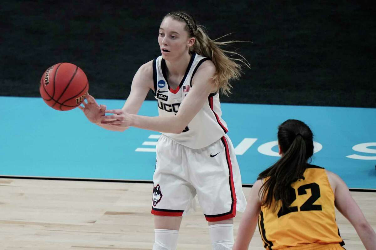 Iowa's Caitlin Clark defends UConn's Paige Bueckers during the first half of the Sweet 16 during the NCAA tournament on Saturday at the Alamodome in San Antonio.