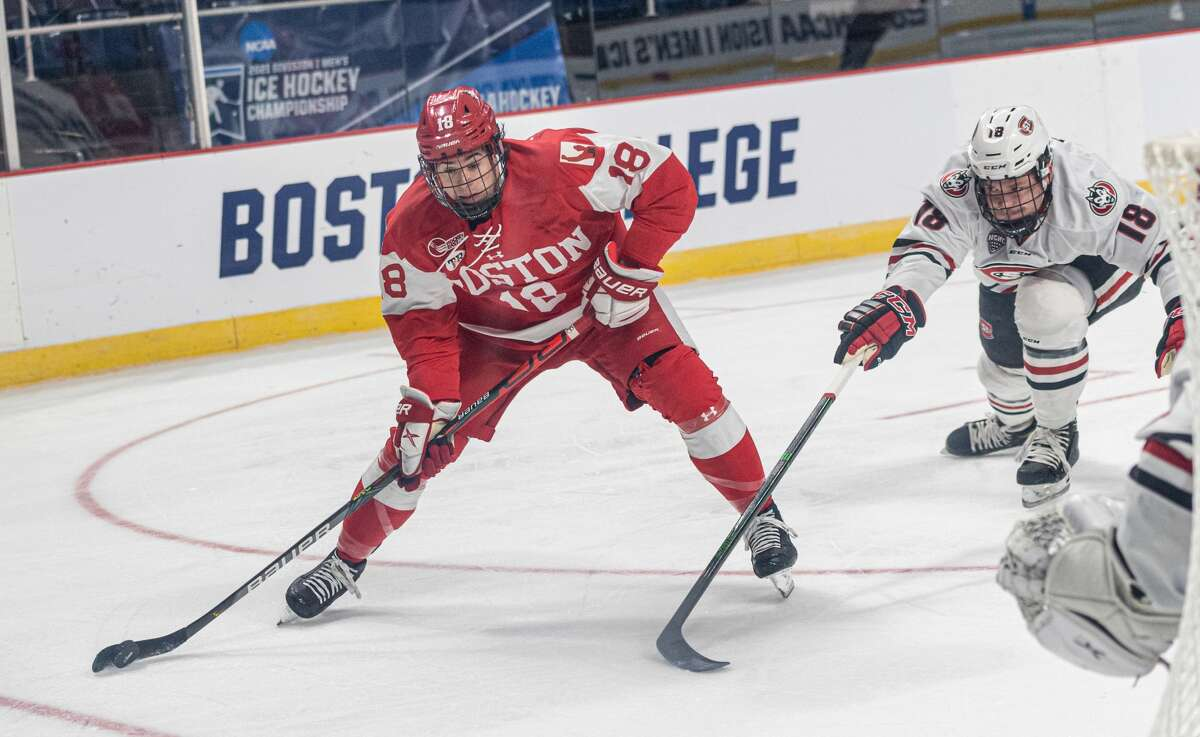 A pair of 18s, Jay O'Brien, left, for Boston University and Brendan Bushy of St. Cloud State, battle for the puck in an NCAA hockey Albany Regional game Saturday, March 27, 2021, at Times Union Center. (Robert Simmons/Times Union Center)