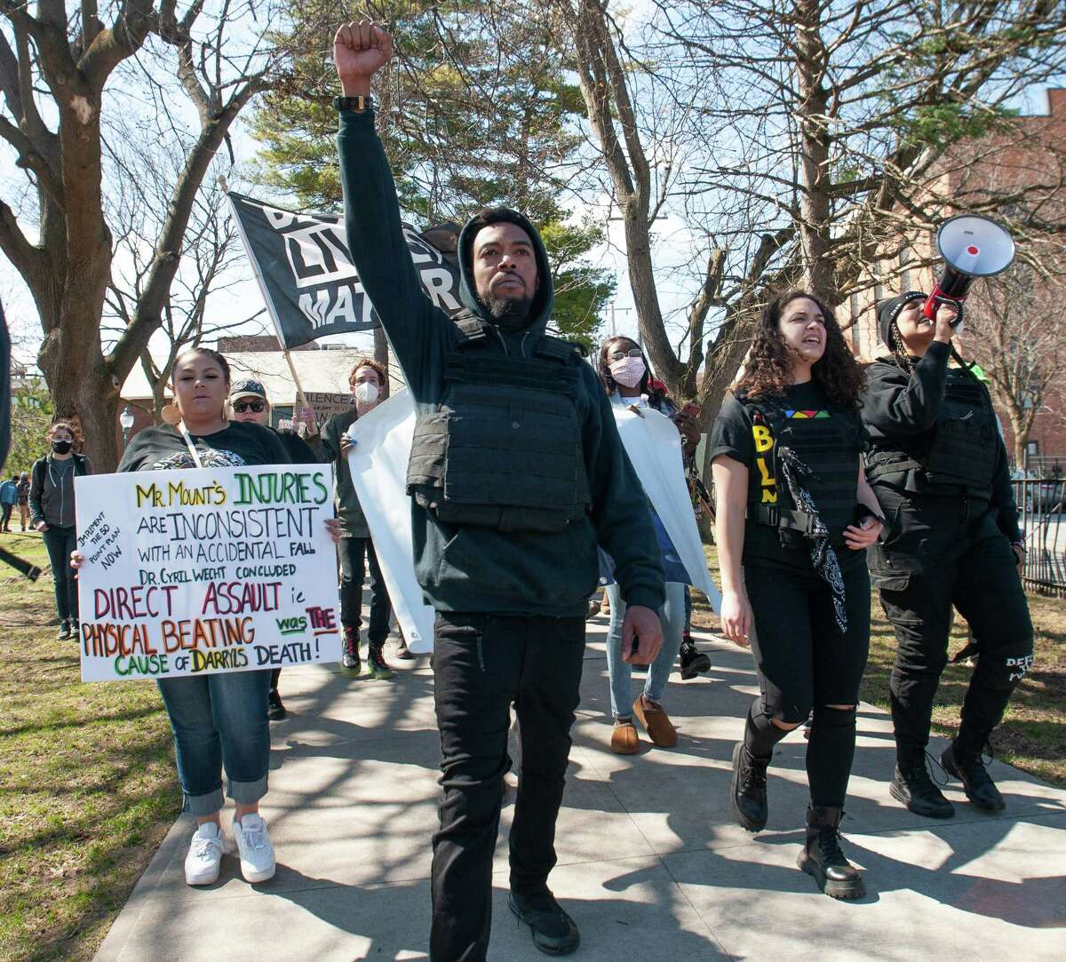 Saratoga Black Lives Matter leader Lexis Figuereo, center, leads a march from Congress Park on Saturday, March 27, 2021. He was among the activists arrested this month. (Jenn March, Special to the Times Union )
