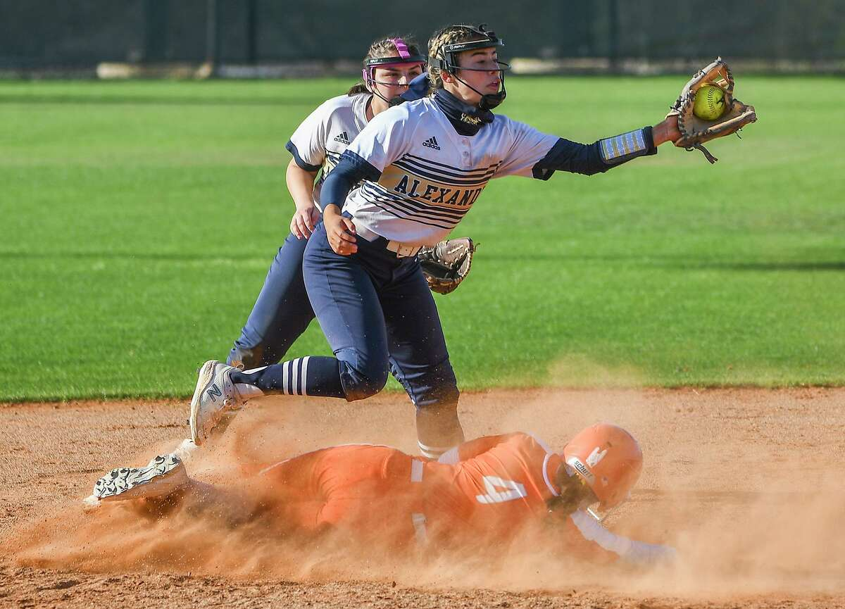 Alexander's Amanda Leija goes for the out as United's Eva Garcia slides into second base on Friday, March 26, 2021 at the SAC.