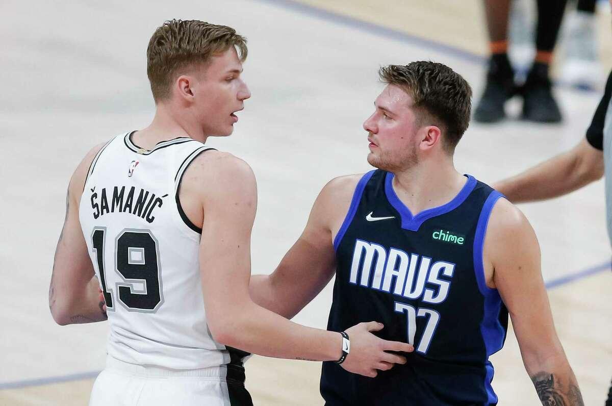 San Antonio Spurs forward Luka Samanic (19) and Dallas Mavericks guard Luka Doncic (77) greet each other after an NBA basketball game, Wednesday, March 10, 2021, in Dallas. Dallas won 115-104. (AP Photo/Brandon Wade)
