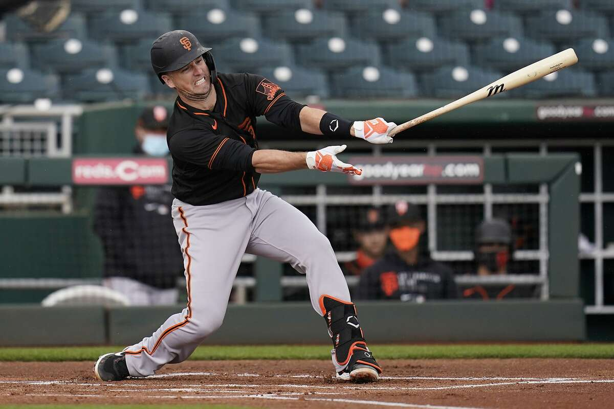 Buster Posey may be behind the plate for the Giants when they face the A's in Arizona at 1 p.m. Sunday. (NBCSBA)