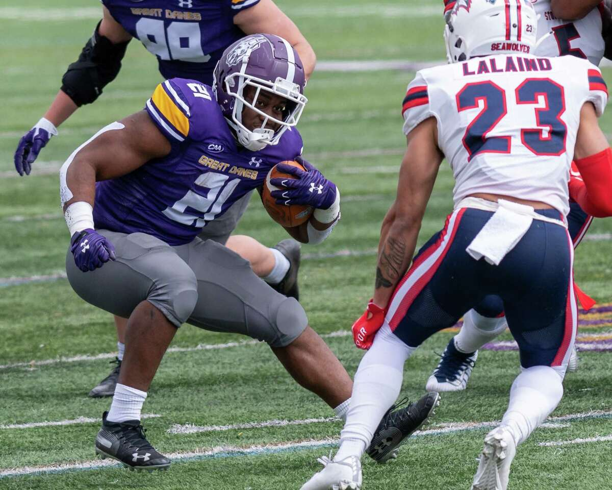 UAlbany running back Karl Mofor look for room in front of Stony Brook defender Akeal LaLaind at Casey Stadium on the UAlbany campus on Saturday, March 27, 2021. (Jim Franco/Special to the Times Union)