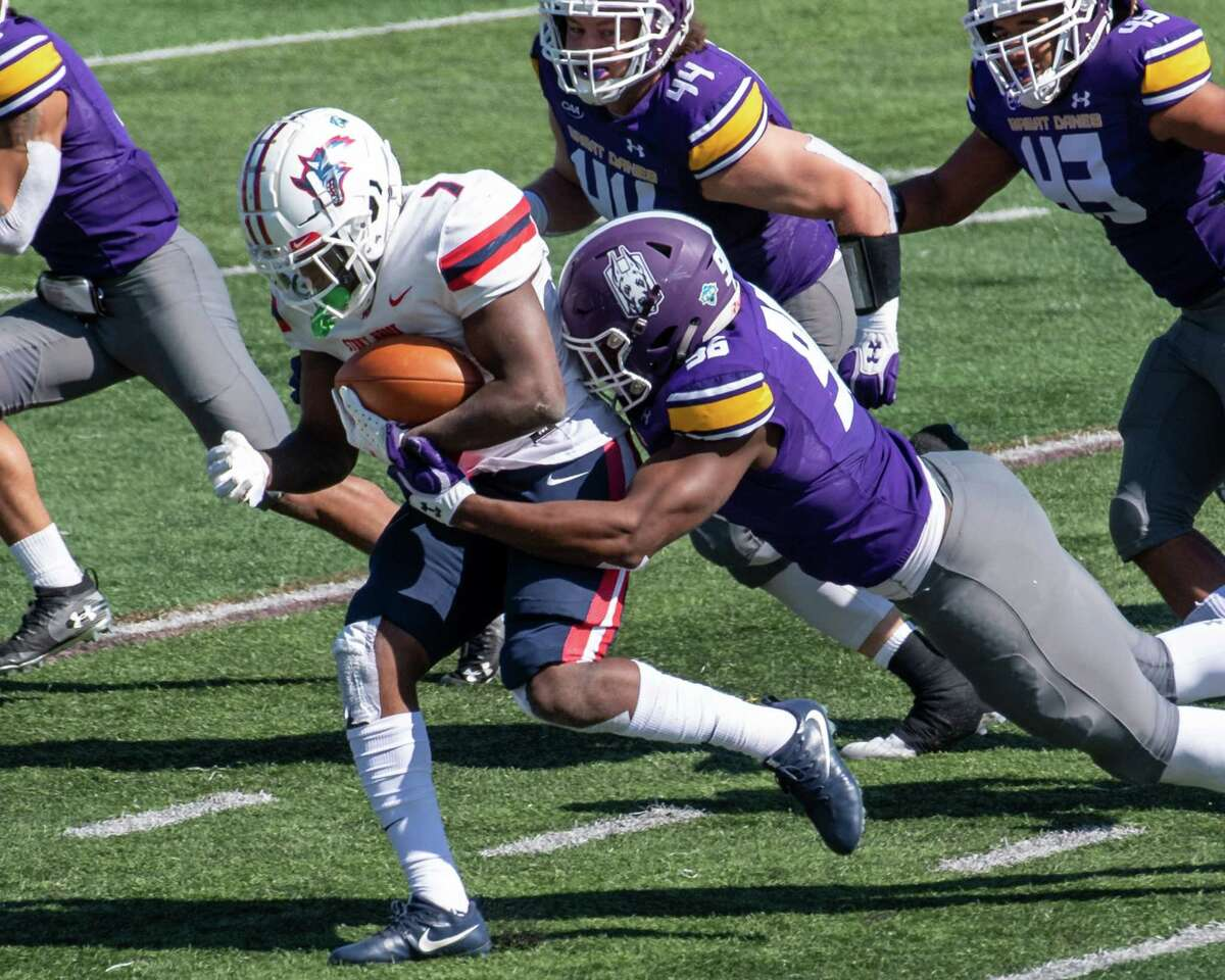UAlbany freshman Jared Verse drags down Stony Brook sophomore Ty Son Lawton at Casey Stadium on the UAlbany campus on Saturday, March 27, 2021. (Jim Franco/Special to the Times Union)