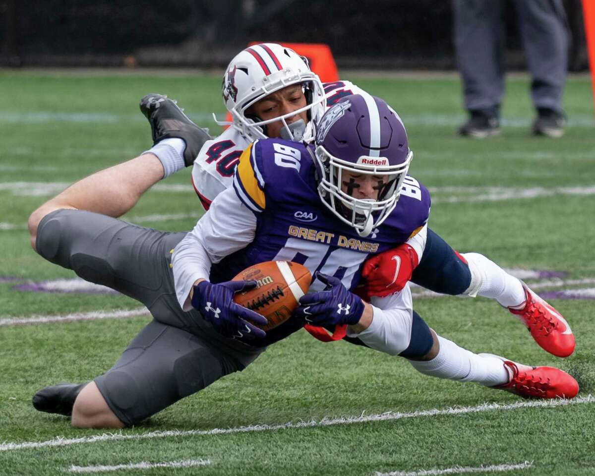 UAlbany receiver Mike Gray makes a diving catch in front of Stony Brook defender Randy Pringle at Casey Stadium in the spring. He had 16 catches for 187 yards in four games. (Jim Franco/Special to the Times Union)