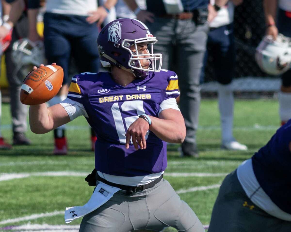 UAlbany quarterback Joey Carino throws a pass against Stony Brook at Casey Stadium on the UAlbany campus on Saturday, March 27, 2021. (Jim Franco/Special to the Times Union)