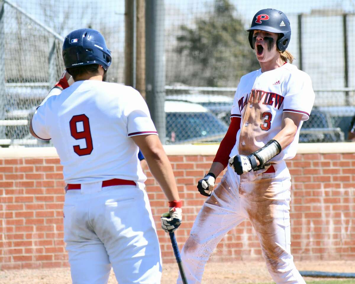 Plainview's Caleb Lusk (right) celebrates his inside-the-park home run with teammate Charles Gipson during a District 3-5A baseball game against Amarillo Palo Duro on Saturday at Bulldog Park.