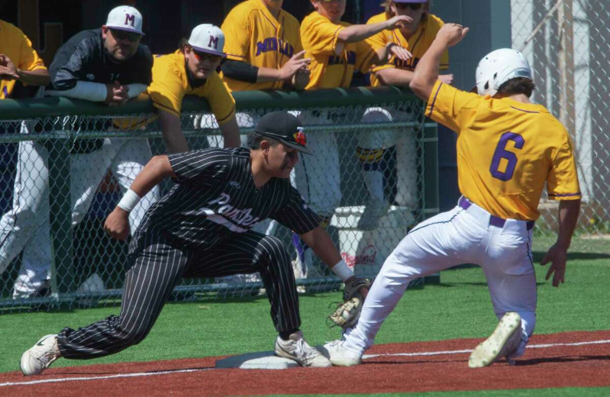 Midland High's Jacob Smith safely slides into third as Permian's Xavier Melendez tries to tag him out 03/26/21 at Zachery Field. Tim Fischer/Reporter-Telegram