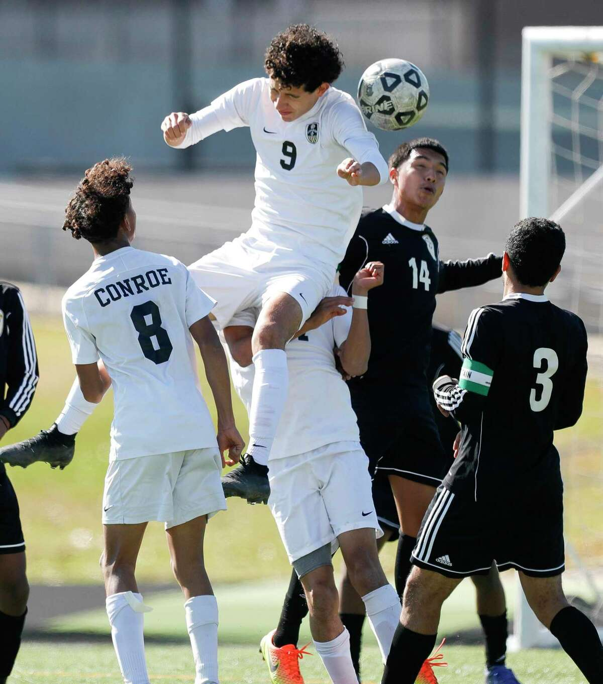 Conroe's David De La Paz (9) heads the ball against Sharpstown's Alexis Vargas Revollar (14) in the first period of a match during the Kilt Cup soccer tournament, Saturday, Jan. 9, 2021, in Conroe. Conroe defeated Sharpstown 4-3.