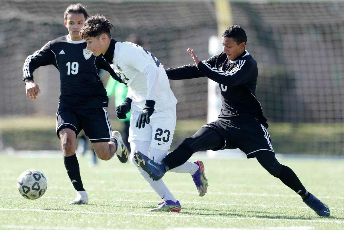 Conroe's Julian Vega (23) is fouled from behind by Sharpsdown's Brayan Espinoza Garay (6) in the second period of a match during the Kilt Cup soccer tournament, Saturday, Jan. 9, 2021, in Conroe. Conroe defeated Sharpstown 4-3.