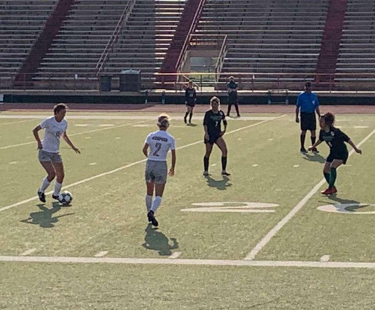 Kempner's Cera Moreno and Elizabeth Werts work against the Sharpstown defense during their Region III-5A bi-district soccer playoff March 26 at Butler Stadium.