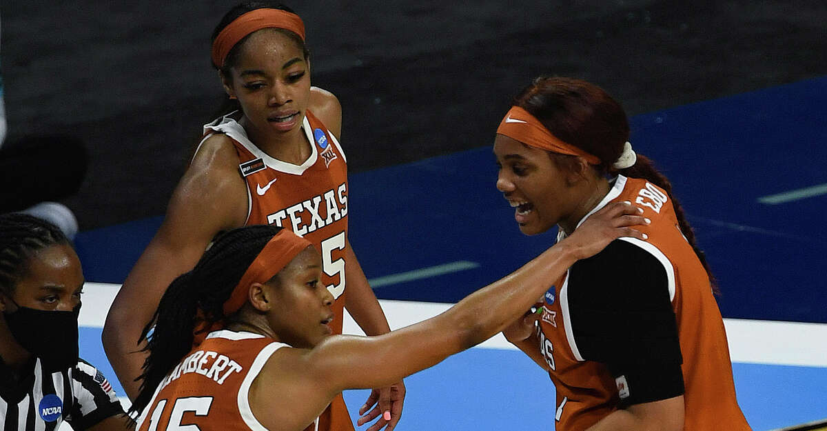 Kyra Lambert (15), Charli Collier, middle, and Lauren Ebo of Texas encourage one another in their NCAA Women's Basketball Championship tournament game against UCLA in the Alamodome on Wednesday, March 24, 2021.