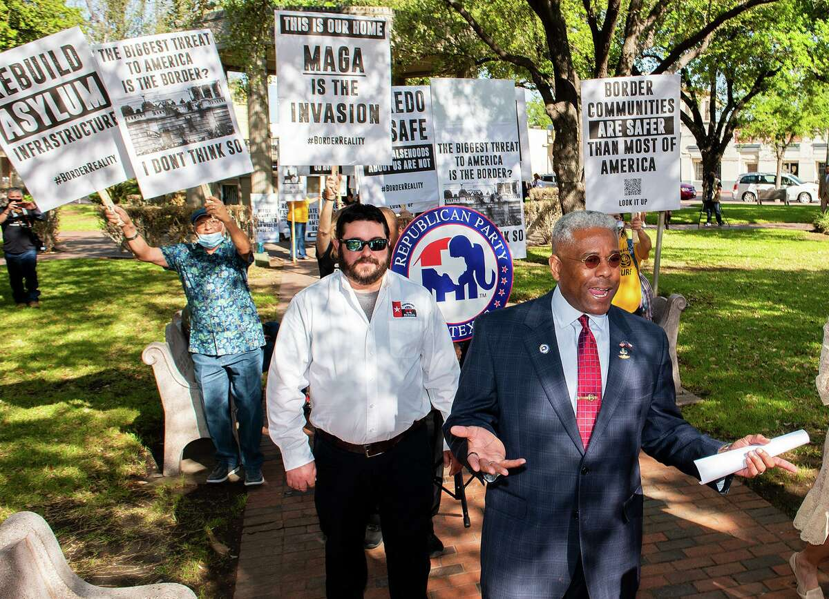 Chairman of the Texas GOP Allen B. West, right, and other Republican Party of Texas members return to La Posada Hotel's San Agustin Ballroom as The No Border Wall Coalition protests their Laredo rally on Friday.