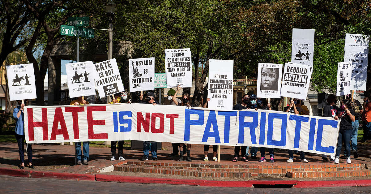 The No Border Wall Coalition and other activists gather near a meeting of the Republican Party of Texas in protest of rhetoric used when discussing immigration and border security, Friday, Mar. 26, 2021 at San Agustin Plaza