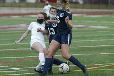 Jules Monlea of Schalmont collides with Marissa DeMartino (5) and Madeline Stallmer (13) of Holy Names during a varsity game Saturday, March 27 at Watervliet High School. (Jon Winslow/ Special to Times Union)