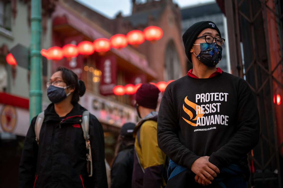 Chinatown Saftey Patrol volunteers Anthony Su and Paul Park patrol San Francisco Chinatown on March 18, 2021. With the increase of crimes against Asian Americans and the mass shooting in Atlanta, a drastic increase of volunteers have showed up every night to help residents feel safe by patroling Asian American neighborhoods.