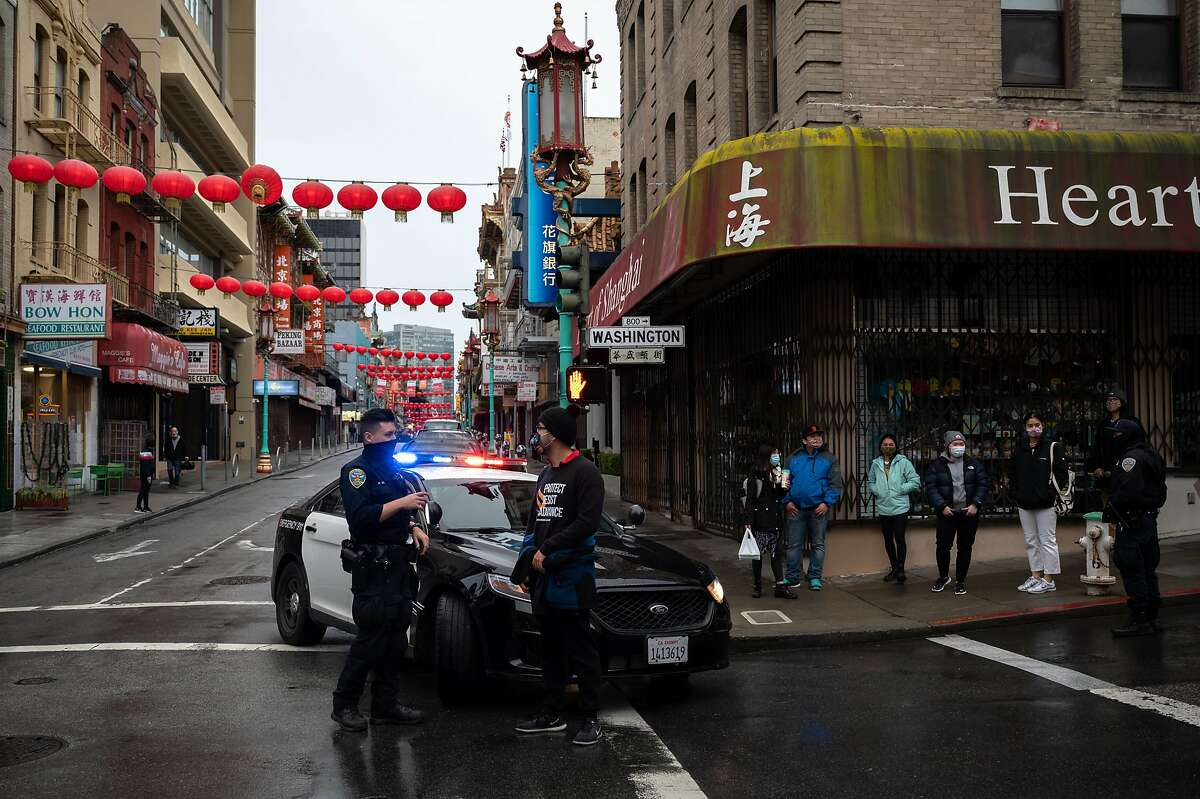 San Francisco police Officer William Ma chats with and Chinatown Safety Patrol co-founder Forrest Liu on March 18, 2021. Ma's partner said they volunteered for the Chinatown beat because of the familial ties to the district.