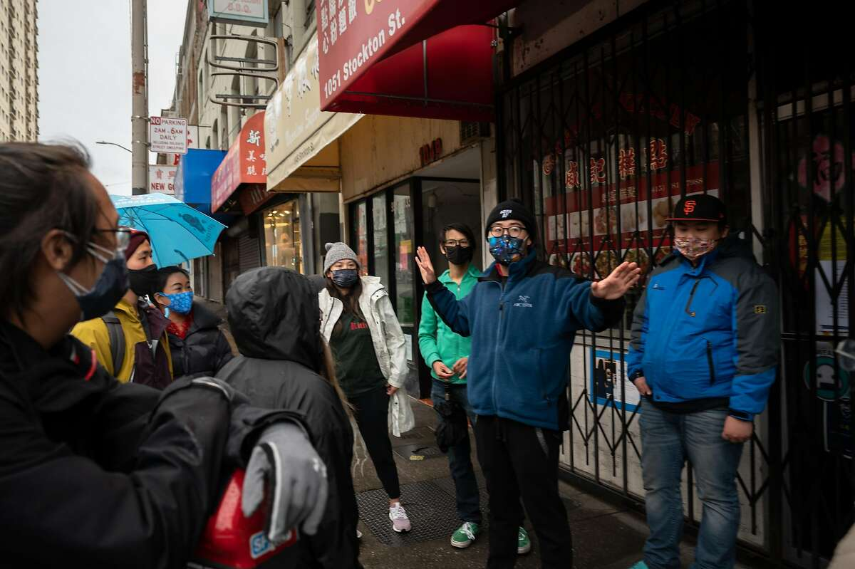Chinatown Saftey Patrol co-founder Forrest Liu organizes a four-hour shift with his volunteers on March 18, 2021. Liu started the patrol group in February in response to attacks on Asian Americans.