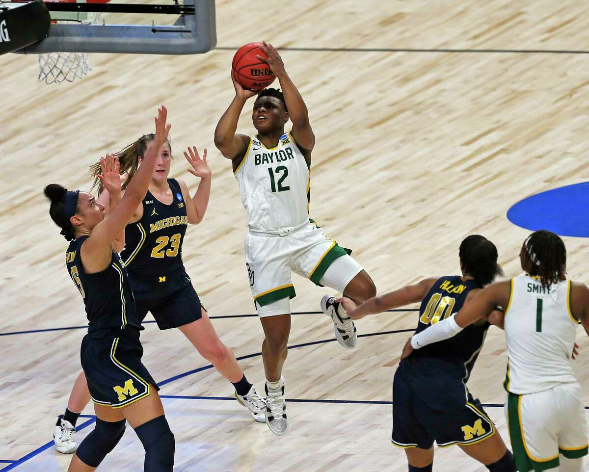 Baylor guard Moon Ursin (12) scores past Baylor defenders in the first half on Saturday, March 27, 2021 at the Alamodome.