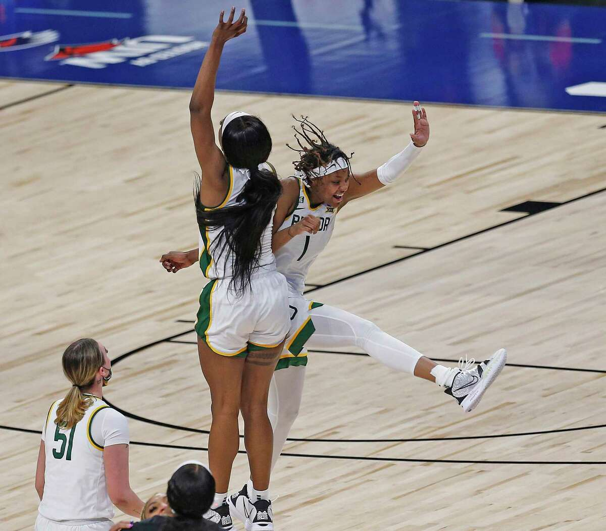 Baylor forward NaLyssa Smith (1) celebrates with Baylor center Queen Egbo (25) after Baylor defeated Michigan 78-75 in OT on Saturday, March 27, 2021 at the Alamodome.