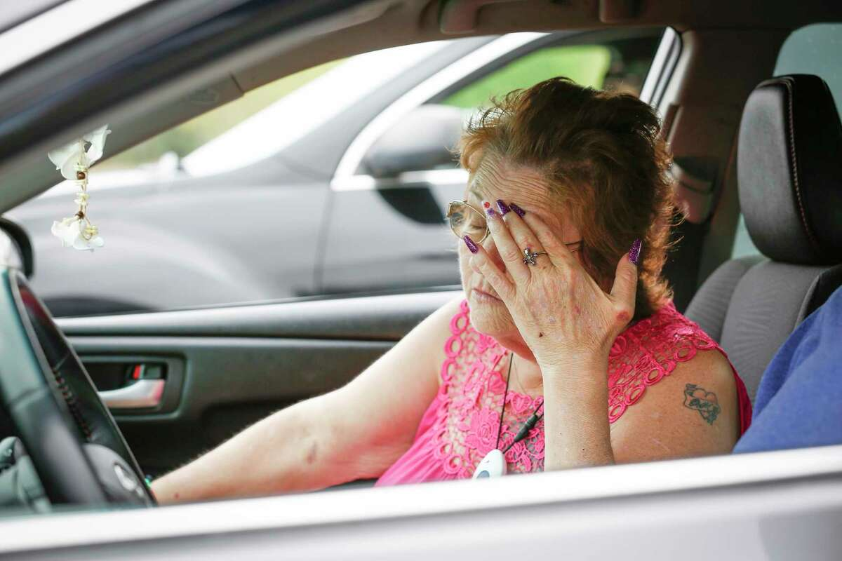 Theresa Claycomb's frustration show as she wait to be seen during a rent assistance event through the joint Houston-Harris County Emergency Rental Assistance Program and the Texas Rent Relief Program at the Greenspoint Harvest Time Church Saturday, March 27, 2021, in Houston.