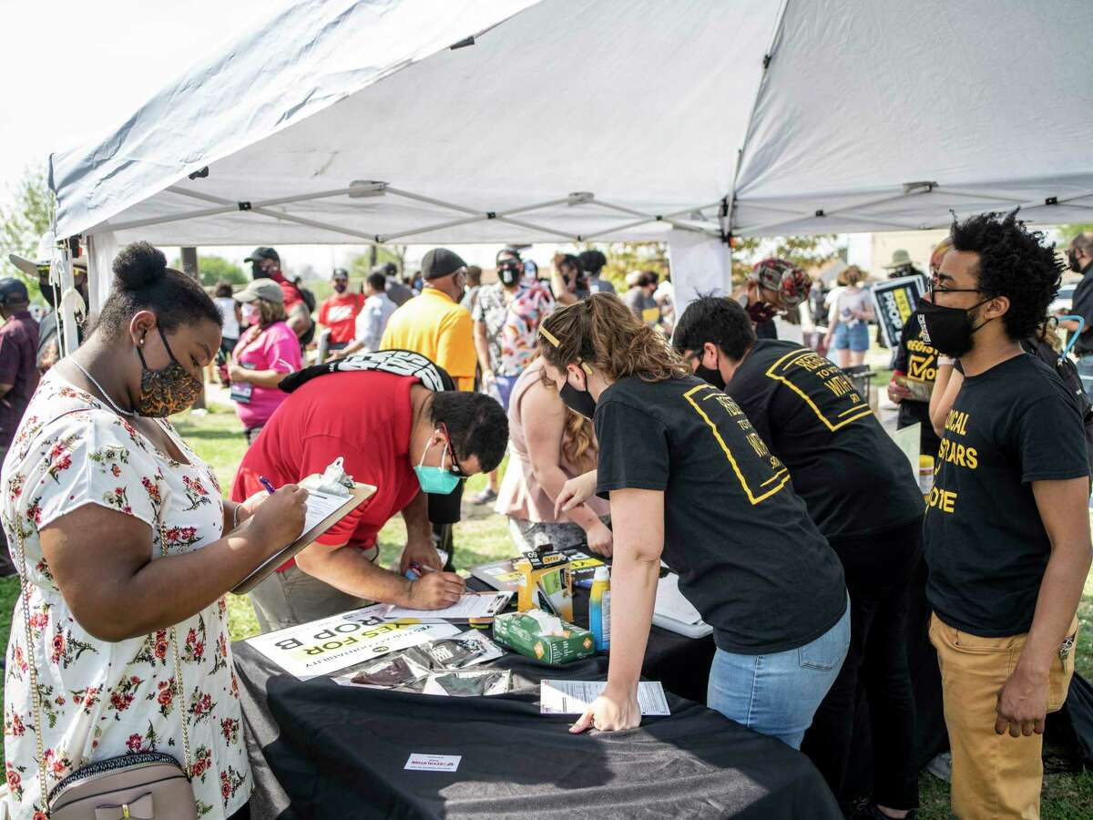 The group Radical Registrars registers people to vote during a rally to support Proposition B, which repeal the San Antonio police union's ability to collectively bargain with the city. The rally, which drew about 200 people, was held at Pittman-Sullivan Park on Saturday.