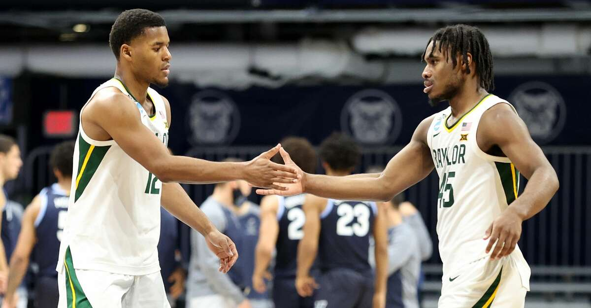 Jared Butler #12 and Davion Mitchell #45 of the Baylor Bears react in the second half of their Sweet Sixteen game against the Villanova Wildcats in the 2021 NCAA Men's Basketball Tournament at Hinkle Fieldhouse on March 27, 2021 in Indianapolis, Indiana. (Photo by Andy Lyons/Getty Images)
