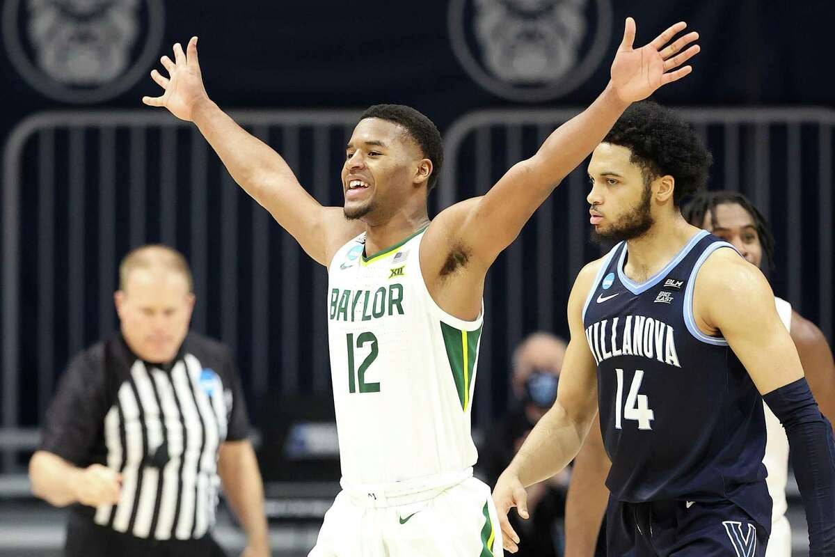 Baylor's Jared Butler, who finished with nine points, celebrates during the Bears' victory over the Wildcats at Hinkle Fieldhouse in Indianapolis.