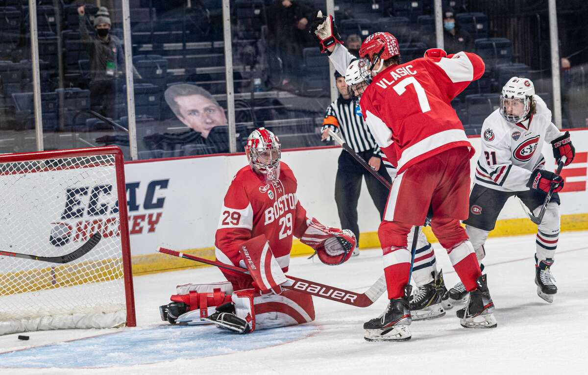 Boston University defenseman Alex Vlasic (7) and goaltender Drew Commesso look on helplessly as the puck enters the net in the second period of an NCAA hockey Albany Regional game at Times Union Center. A shot by St. Cloud State's Nick Perbix (not pictured) ricocheted off two BU players, including Vlasic, to give the Huskies a 2-1 lead. (Robert Simmons/Times Union Center)