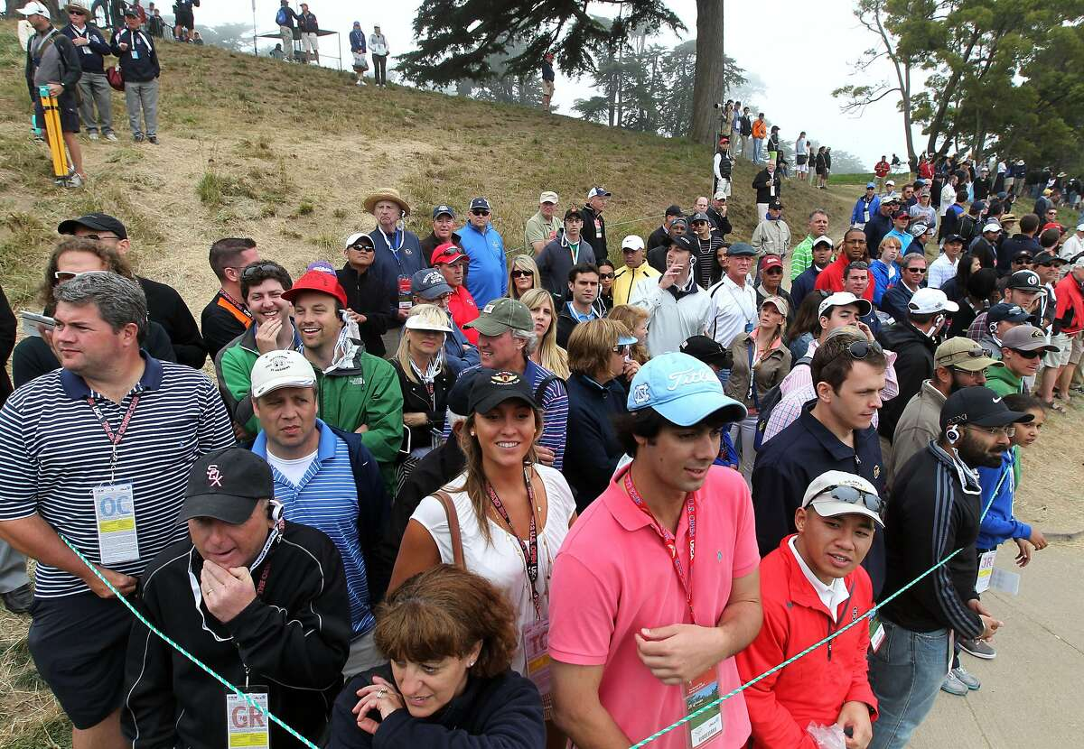 Scenes like this from the 2012 U.S. Open - fans crammed next to each other - will not happen at this year's U.S. Women's Open at The Olympic Club.