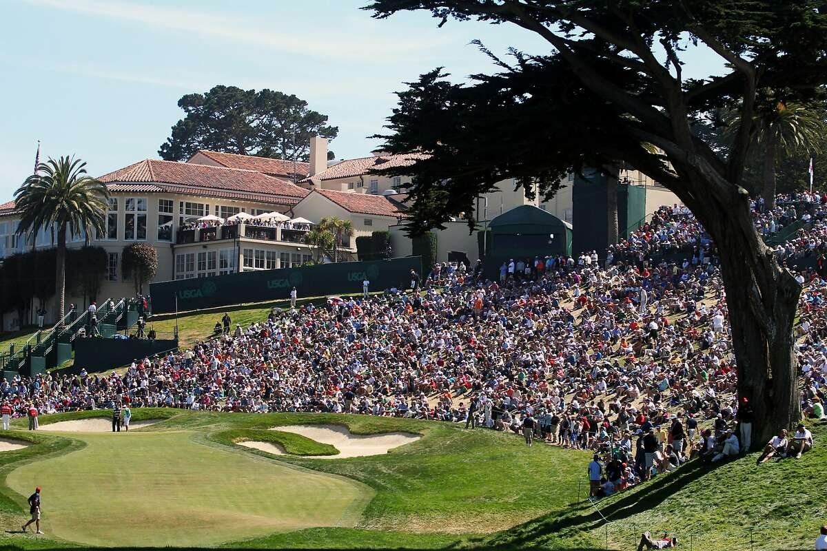 Thousands of golf fans surround the 8th hole during the third round of the U.S. Open at The Olympic Club in June 2012.