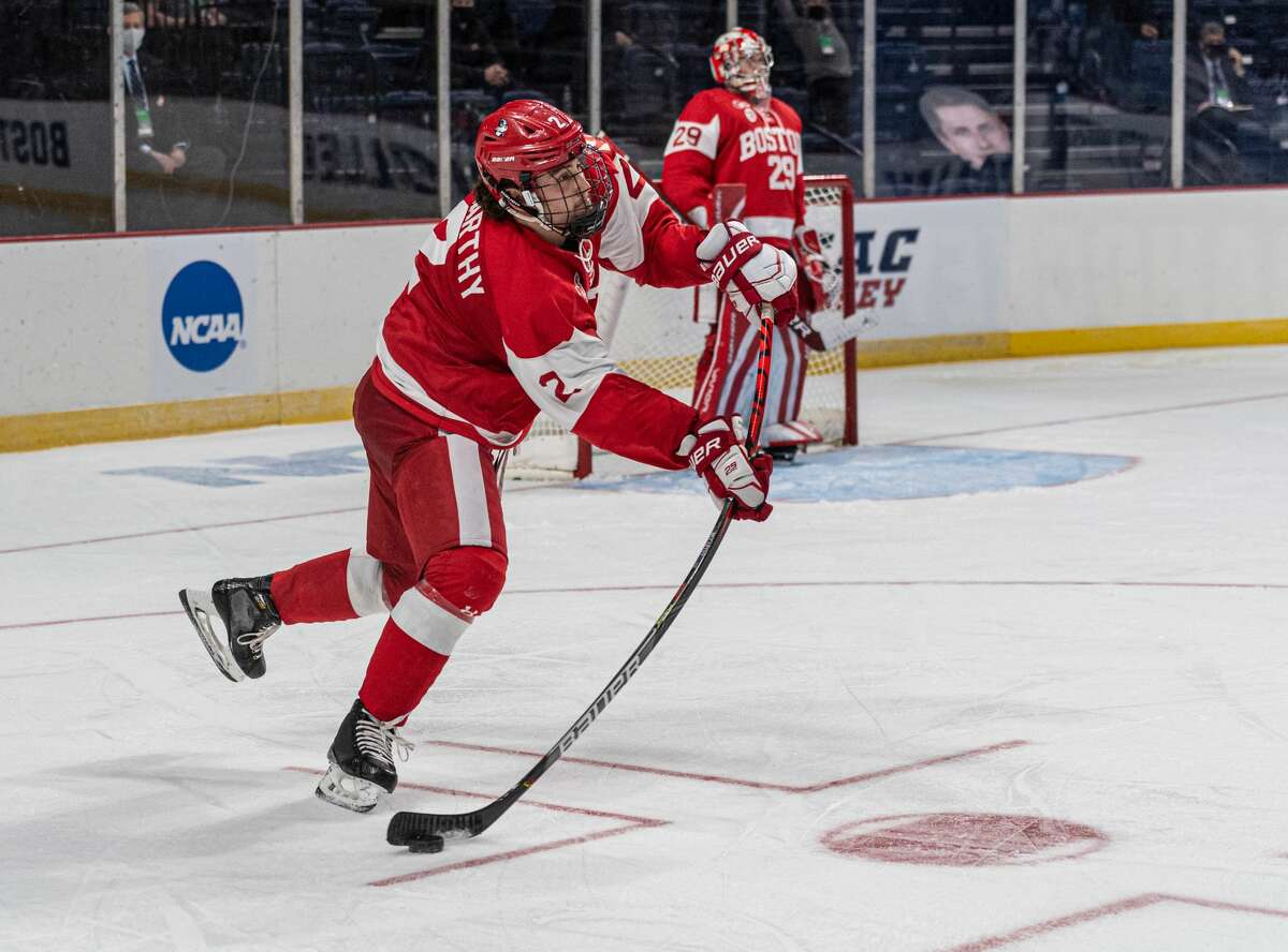 The stick of Boston University defenseman Case McCarthy bends as he makes a pass out of his zone against St. Cloud State in an NCAA hockey Albany Regional game Saturday, March 27, 2021, at Times Union Center. (Robert Simmons/Times Union Center)