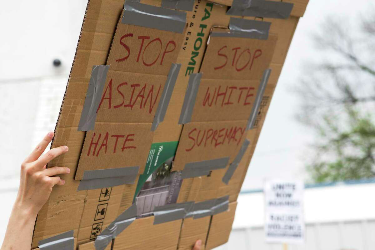 Demonstrators gather for a rally for a National Day of Action demanding an end to hate crimes targeting Asian American communities Saturday, March 27, 2021 in Houston.