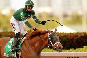 HALLANDALE, FLORIDA - MARCH 27: Known Agenda #5, ridden by Irad Ortiz Jr., wins the 69th running of the Florida Derby at Gulfstream Park on March 27, 2021 in Hallandale, Florida.