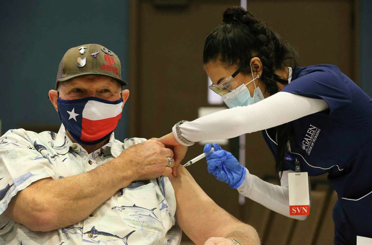 Terry Littlepage wears a Texas flag-themed mask as he receives a Covid-19 vaccination from nursing student Maresah Olivarez as Comal County and City of New Braunfels team up to create a COVID-19 Vaccination Center to give out 200 shots to area residents on Thursday, Jan. 21, 2021. Supervised nursing students from the Galen College of Nursing San Antonio campus gave the injections to residents who registered about two weeks ago. People received the vaccination made by Moderna. Cheryl Fraser, director of public health for Comal County, said she requested several thousand doses but were only allowed 500. Of that amount, 200 doses were given out at the New Braunfels Civic Center in rapid fashion. Most people, once they were checked in, were in and out of the facility under a half hour. Fraser said the people who received the shots today will be notified at a later date for their second injection.