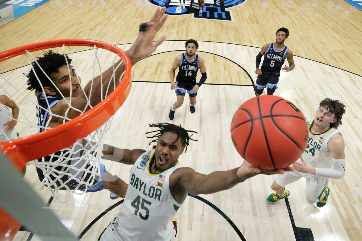 INDIANAPOLIS, INDIANA - MARCH 27: Davion Mitchell #45 of the Baylor Bears goes up for a shot against Jermaine Samuels #23 of the Villanova Wildcats in the second half of their Sweet Sixteen game of the 2021 NCAA Men's Basketball Tournament at Hinkle Fieldhouse on March 27, 2021 in Indianapolis, Indiana. (Photo by Andy Lyons/Getty Images)