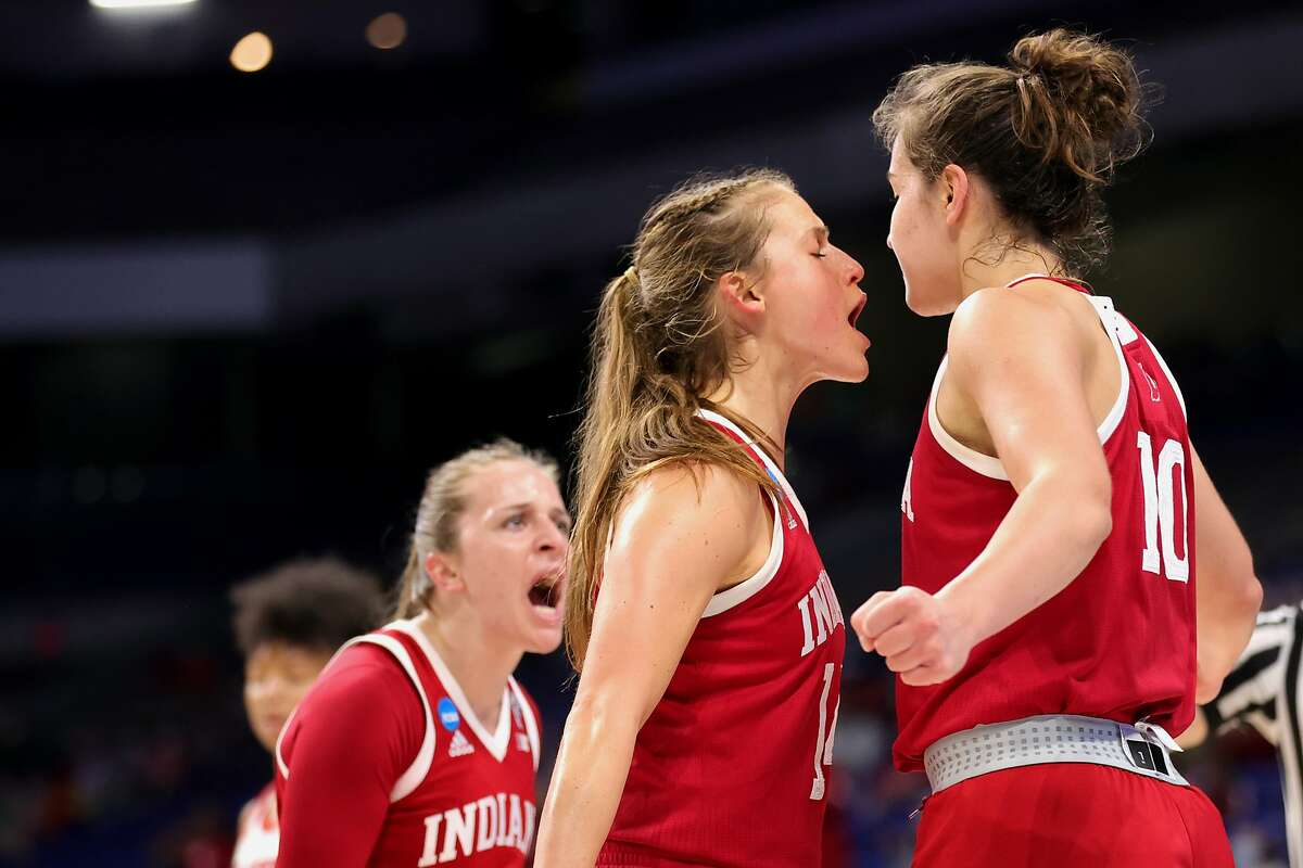 SAN ANTONIO, TEXAS - MARCH 27: Ali Patberg #14 and Aleksa Gulbe #10 of the Indiana Hoosiers react during the first half against the NC State Wolfpack in the Sweet Sixteen round of the NCAA Women's Basketball Tournament at the Alamodome on March 27, 2021 in San Antonio, Texas. (Photo by Carmen Mandato/Getty Images)