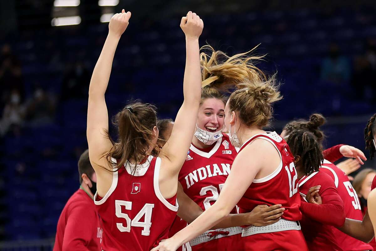 Indiana players celebrate defeating the Mercado Region's top seed, N.C. State, in the Sweet 16.