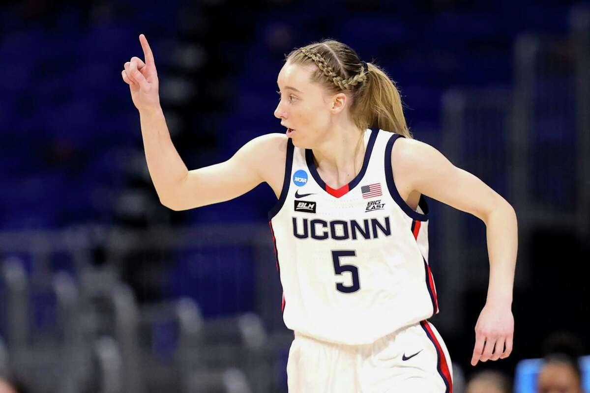 SAN ANTONIO, TEXAS - MARCH 27: Paige Bueckers #5 of the UConn Huskies reacts to a basket against the Iowa Hawkeyes during the first half in the Sweet Sixteen round of the NCAA Women's Basketball Tournament at the Alamodome on March 27, 2021 in San Antonio, Texas. (Photo by Carmen Mandato/Getty Images)